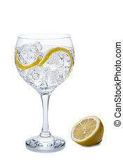 Gin and tonic in a balloon glass garnished with lemon and ...