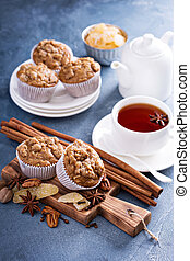 Ginger and nut streusel muffins with winter spices and tea