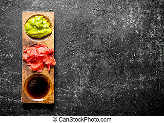 Ginger and wasabi in a wooden stand.