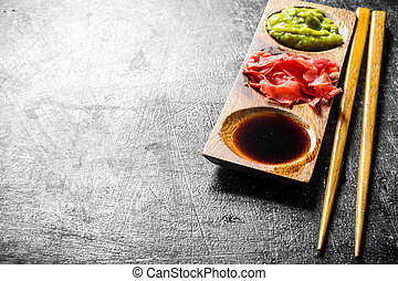 , ginger and wasabi in a wooden stand.