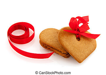 Ginger bread hearts with red ribbon isolated over white