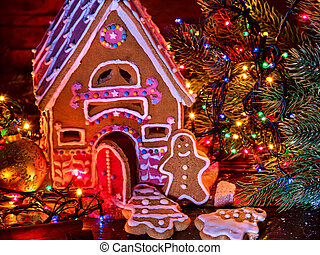 Ginger bread houses with Christmas garland.