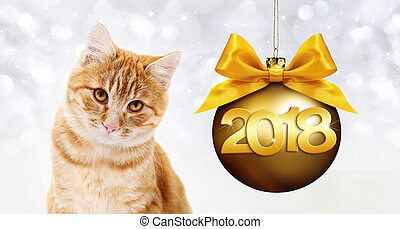 ginger cat and golden christmas ball with ribbon bow and gold 2018 text