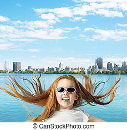 Ginger girl over the city background