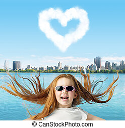 Ginger girl with a heartshaped cloud