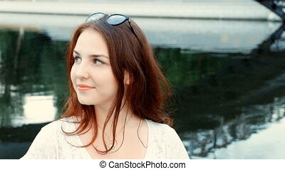 Ginger hair woman smiling and saying hello outside -...