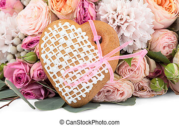 Ginger heart-shaped cookie with lots of flowers isolated on white background