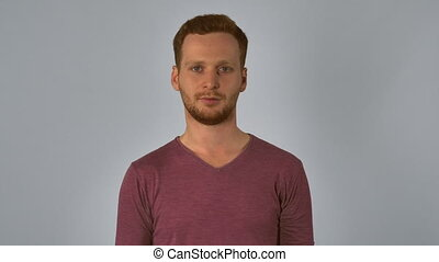 ginger male shows sign approval - Portrait young caucasian...