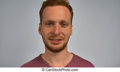 ginger male shows sign don't say - Portrait young caucasian...
