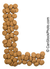 """Little ginger nuts in the form of the letter L. These little ginger nuts are used in Holland for the """"Sinterklaas"""" party, which is at Dec 5 every year. Sinterklaas is a sort of Santa Claus. In Holland these ginger nuts are called """"pepernoot"""". Isolated on white."""
