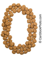 """Little ginger nuts in the form of the letter O. These little ginger nuts are used in Holland for the """"Sinterklaas"""" party, which is at Dec 5 every year. Sinterklaas is a sort of Santa Claus. In Holland these ginger nuts are called """"pepernoot"""". Isolated on white."""