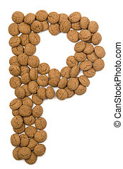 """Little ginger nuts in the form of the letter P. These little ginger nuts are used in Holland for the """"Sinterklaas"""" party, which is at Dec 5 every year. Sinterklaas is a sort of Santa Claus. In Holland these ginger nuts are called """"pepernoot"""". Isolated on white."""