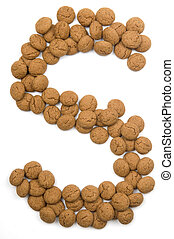 """Little ginger nuts in the form of the letter S. These little ginger nuts are used in Holland for the """"Sinterklaas"""" party, which is at Dec 5 every year. Sinterklaas is a sort of Santa Claus. In Holland these ginger nuts are called """"pepernoot"""". Isolated on white."""