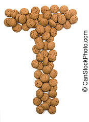 """Little ginger nuts in the form of the letter T. These little ginger nuts are used in Holland for the """"Sinterklaas"""" party, which is at Dec 5 every year. Sinterklaas is a sort of Santa Claus. In Holland these ginger nuts are called """"pepernoot"""". Isolated on white."""