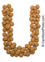 """Little ginger nuts in the form of the letter U. These little ginger nuts are used in Holland for the """"Sinterklaas"""" party, which is at Dec 5 every year. Sinterklaas is a sort of Santa Claus. In Holland these ginger nuts are called """"pepernoot"""". Isolated on white."""