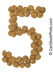 """Little ginger nuts in the form of the digit five. These little ginger nuts are used in Holland for the """"Sinterklaas"""" party, which is at Dec 5 every year. Sinterklaas is a sort of Santa Claus. In Holland these ginger nuts are called """"pepernoot"""". Isolated on white."""