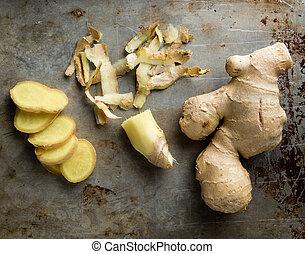 fresh healthy sliced ginger root on steel plate