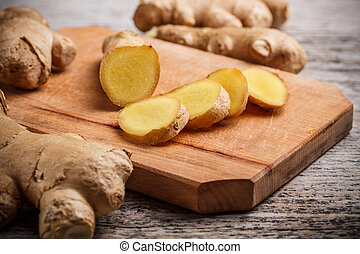 Ginger root on a wood cutting board