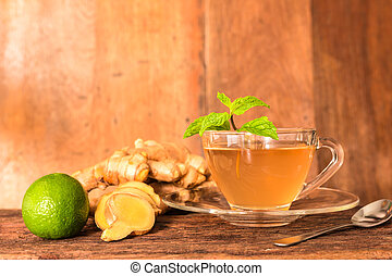 Ginger tea - Cup of ginger tea with green lemon, ginger...
