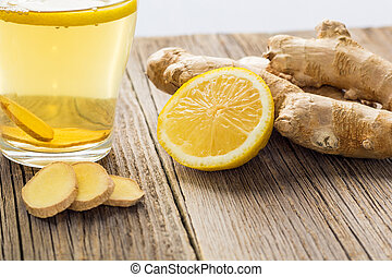 Ginger tea with lemon and honey on a wooden background. Hot healthy winter drink