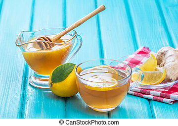 Ginger tea with lemon in a cup