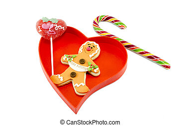Gingerbread a candy cane and a lollipop in box