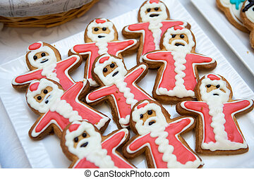 Gingerbread and cookies in the shape of a Santa Claus