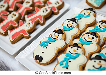 Gingerbread and cookies in the shape of a snowman and Santa Claus