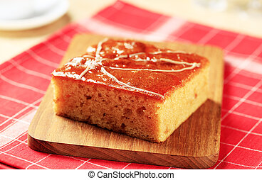 Piece of gingerbread cake glazed with syrup