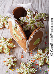 Gingerbread Christmas bag with snowflakes on a table. vertical