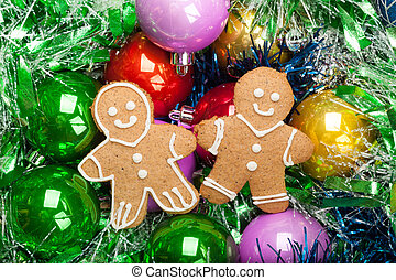 Gingerbread Christmas Men with bunch of Colorful baubles and tinsel