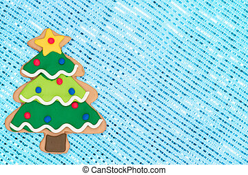 Gingerbread Christmas tree on blue sparkle background