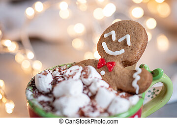 Gingerbread cookie man in a hot chocolate