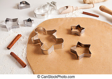 Gingerbread cookies dough preparation recipe with cinnamon and flour on white kitchen table. Traditional homemade christmas dessert.