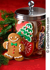 Gingerbread man next to a cookie jar filled with Christmas cookies