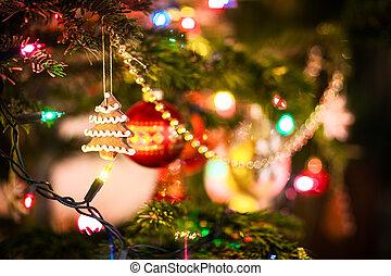 Gingerbread cookies hanging on Christmas tree