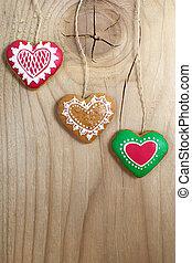 Gingerbread cookies hanging on wood