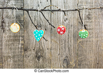 gingerbread cookies hanging on wooden background