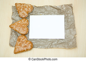 cookies in the form of heart on a paper background