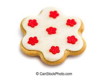 Gingerbread cookies with royal icing in the shape of a flower