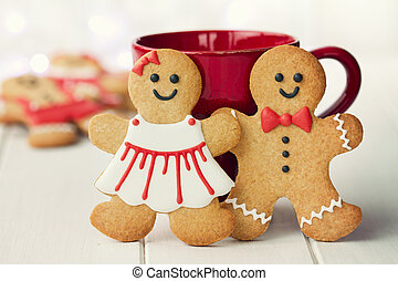 Gingerbread couple - Gingerbread man and woman in red and...