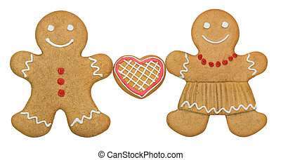 Gingerbread couple holding a heart shaped cookie