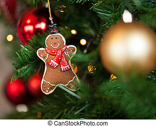 Gingerbread hanging on christmas tree
