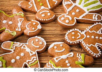 Gingerbread happy creatures on wood - Christmas concept with...