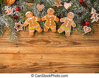 Gingerbread happy creatures on wood - Christmas still life...
