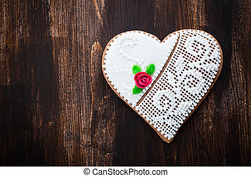 Gingerbread heart cookie on wooden background