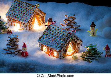 Gingerbread home with snowman and santa