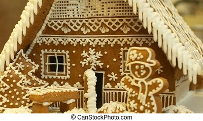 Gingerbread house and cottage cake beautiful, tree with houses and snowman, decorated with a confectionery white icing with beaten egg whites, folk creative work, Christmas time, winter snow