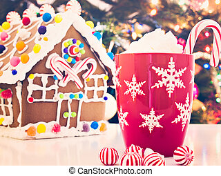 Gingerbread house decorated with candies with Christmas tree...