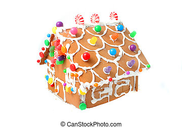gingerbread house kit with different colored candy and...